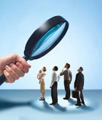 Magnifying glass representing skip tracing services to find someone