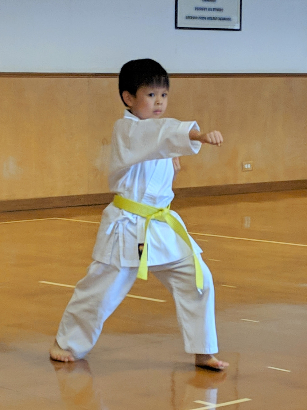 Youth karate student performs martial arts skills after months of dedicated training in New Orleans.