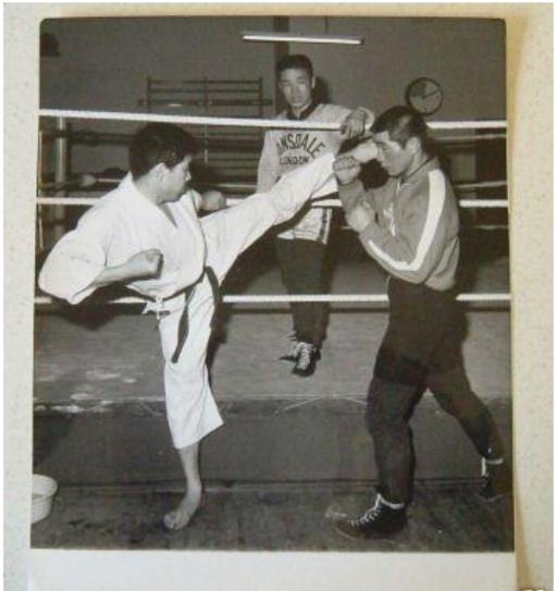 Sensei Mikami trains boxing with fellow JKA karate sensei in 1970s.