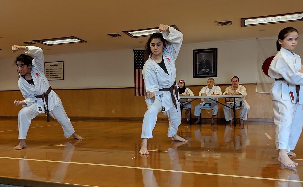 Karate girls perform kata during belt test at the LKA martial arts school
