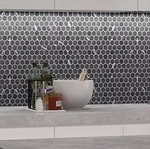 black kitchen backsplash mosaic with a pennyround style