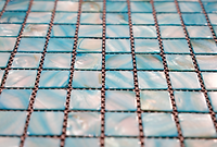 turquoise square grid of mosaic tiles