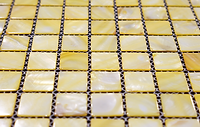 Pale yellow square grid of mosaic tiles