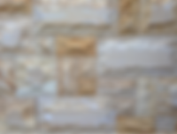 Sandstone wall cladding of natural stone with raised and uneven surface