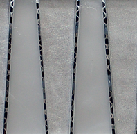 Silver triangular interlocking vertical glass tiles