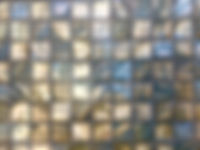 green/ brown square grid of mosaic tiles