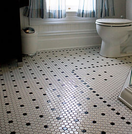 Small mosaic floor tiles blac and