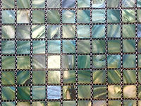 mixed green square grid of mosaic tiles