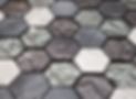 grey, beige and white hexagon mosaics in a sheet with liquid ripples and rough finishes