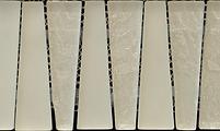 White triangular interlocking vertical glass tiles