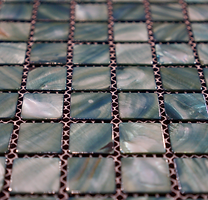 light grey and green square grid of mosaic tiles