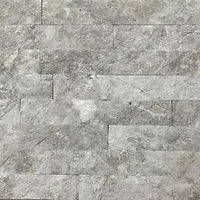 Smooth steel grey wall cladding, perfectly flush with a natural stone look