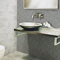 Italian bespoke mosaic tiles serving as a contrasting wall behind a bathroom basin
