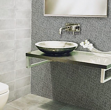 Italian bespoke mosaic tiles serving as a contrasting wall behind a bathroom basin