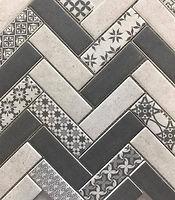 Interlocking rectangular tiles with a grey and white herringbone finish