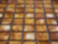 burnt orange square grid of mosaic tiles