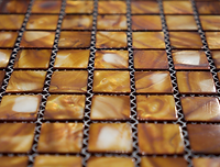 burnt orange square grid of mosaic tiles