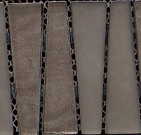 Bronze triangular interlocking vertical glass tiles