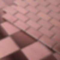 rose gold metallic squares in a sheet, some are roughened and some have a glossy matte surface