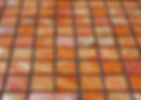 bright orange square grid of mosaic tiles