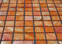 bright orange square grid of mosaic tiles