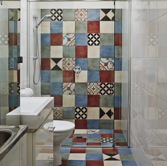 bathroom Shower recess with floor and wall coloured with decorative tiles