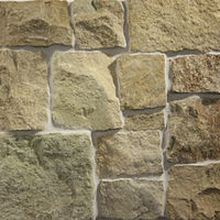 Beige in colour natural stone wall cladding with a rough sandstone finish