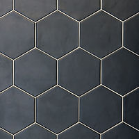 Hexagon shaped matt black ceramic tile, shaped like honeycomb
