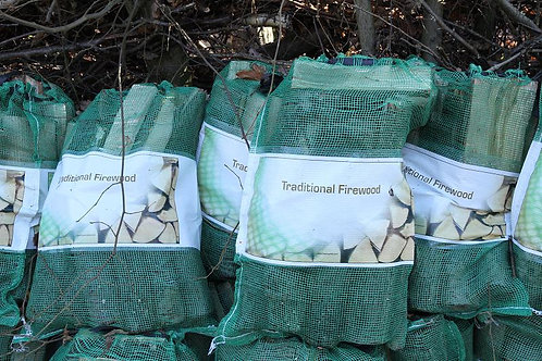 Seasoned LOGS in net bags delivered (crammed full)