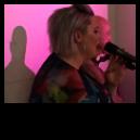 Caoimhe singing at An Droichead