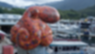 Mosaic octopus sculpture sits on top of a piling cap in Ketchikan, Alaska
