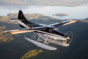 A Misty Fjords Air bush plane flying in Southeast Alaska