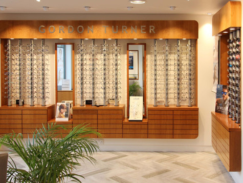 The classic lines, sophisticated palette and quality craftsmanship of our design for this opticians shop is an enduring favourite with staff and customers