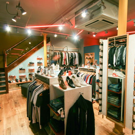 Bespoke fittings showcase apparel and footwear in this high-end retail space