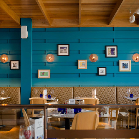 Vibrant colours and bespoke artwork create the perfect casual dining setting