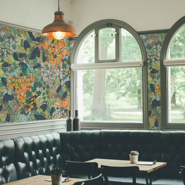 Mockup of our bespoke in-house botanical wallpaper