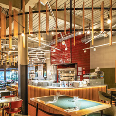 Our pizzaiola design incorporated a bold red mosaic-clad pizza oven