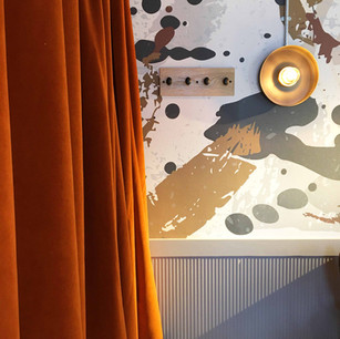 At our restaurant project in Jersey, we designed this bespoke wallpaper which added lots of interest and depth. The colours complemented those in finishes such as the velvet curtains