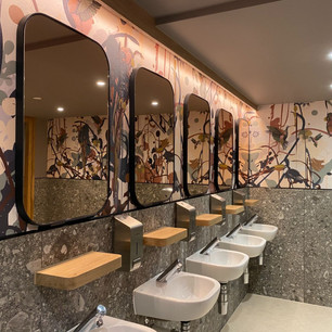 This bespoke wallpaper we designed for the restrooms as part of the restaurant design helped add lots of character