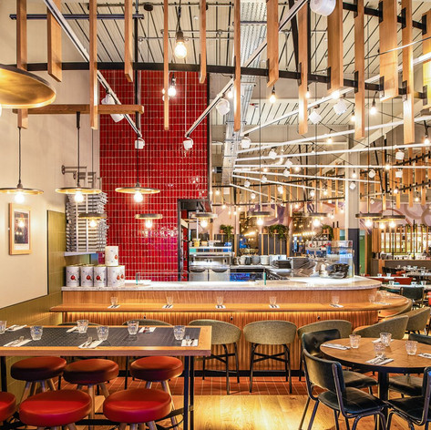 The oak sit-up counter at the pizzaiola makes it a real destination