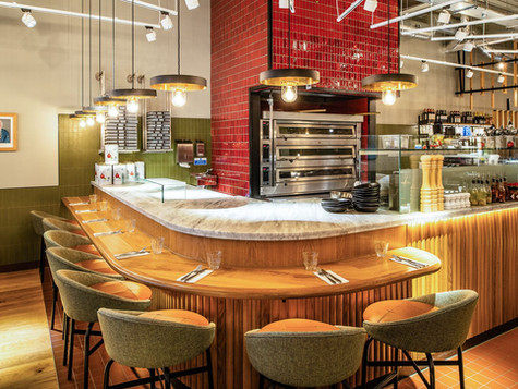 The pizza oven takes centre stage with striking tiles and a sit-up counter at this warm & inviting restaurant