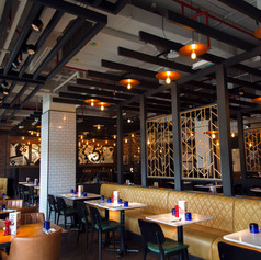 Fret cut copper screens were designed to divide the restaurant environment creating relaxed zones