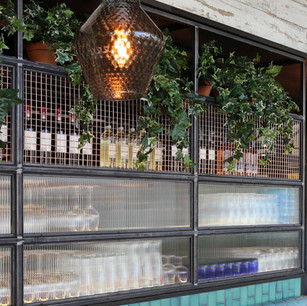 Bespoke wine display detail with copper mesh and fluted glass