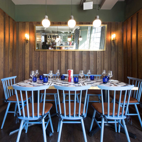Classic dark oak panelling creates a cosy booth for diners