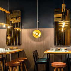 Bespoke high tables and pendant lighting designed in-house