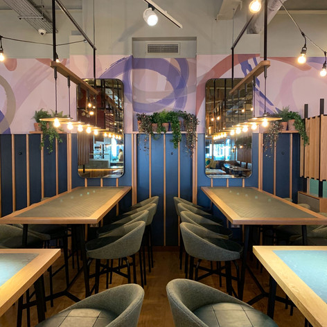 Many bespoke items were incorporated into this project; these mosaic tiled tables, the leather stools and the pendant lights