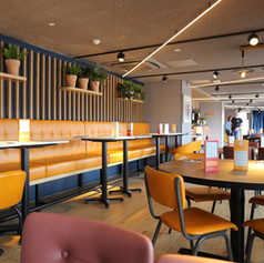 Mustard leather banquette seating with River Thames views