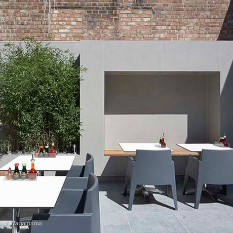 Clean lines and planting make this external dining area attractive to customers
