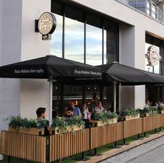 Shopfront with bespoke oak planters