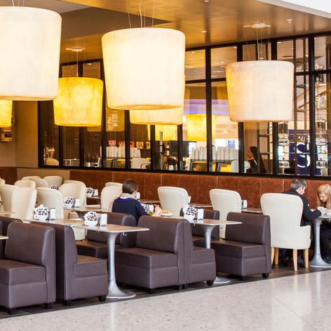 The brands feature lighting creates a warm and soothing glow, enticing travellers into the café